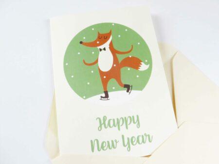Kleurrijke kerstkaart met schaatsende vos